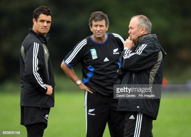 New Zealand All Blacks Dan Carter chats with head coach Graham Henry and coach Wayne Smith during a training session at The Vale Hensol Vale of...