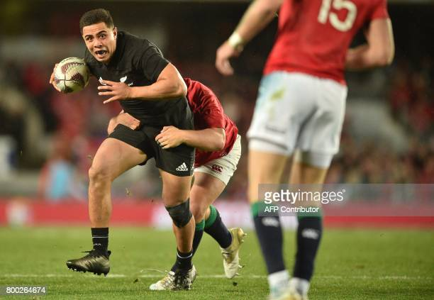 New Zealand All Blacks player Anton LienertBrown is tackled by British and Irish Lions player Ben Te'o during their Test match between New Zealand...