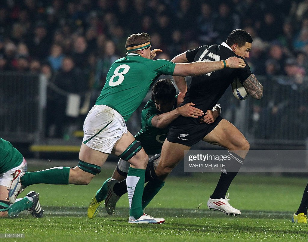 New Zealand All Blacks player Sonny Bill Williams (R) is tackled by Jamie Heaslip of Ireland during their rugby union match at AMI Stadium in Christchurch on June 16, 2012. The All Blacks beat Ireland 22-19 in the second rugby Test. AFP PHOTO / Marty Melville