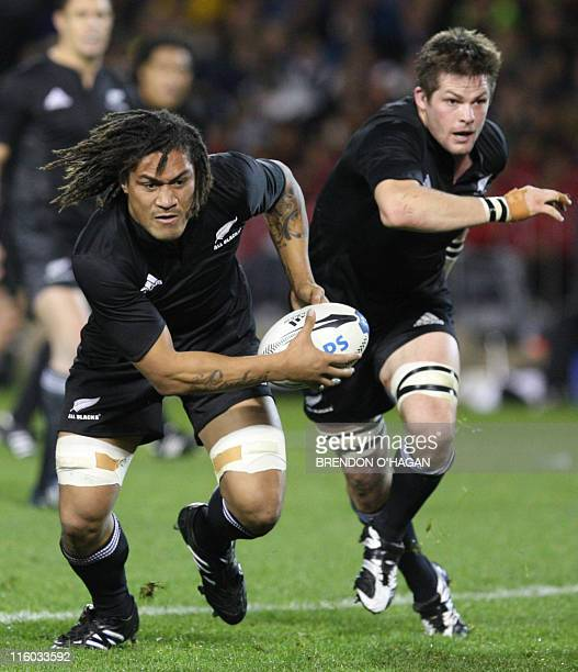 New Zealand All Blacks rugby players Rodney So'oialo and Richie McCaw are seen in action against the Australian Wallabies at Eden Park stadium in...