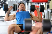 New Zealand All Blacks Sevens player Ben Lam works out in the gym during the New Zealand Commonwealth Games Rugby Sevens Media Opportunity at Next...