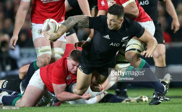 New Zealand All Blacks Sonny Bill Williams offloads the ball during their Test match between New Zealand and the British and Irish Lions at Eden Park...