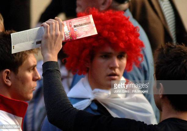 New Zealand All Blacks supporters the pre Tournament favourites to win the Rugby World Cup attempt to sell their match tickets to arriving England...