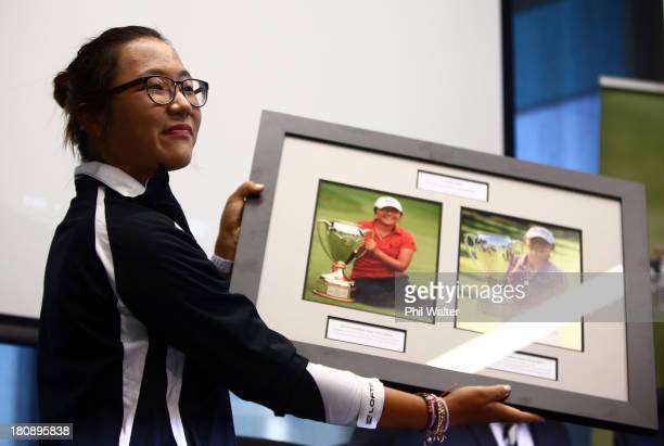 New Zealand amateur golfer Lydia Ko is presented with a photo board displaying her wins following her arrival at Auckland International Airport on...