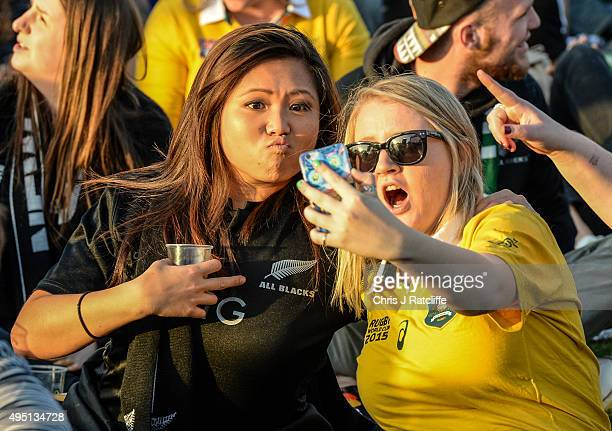 New Zealand and Australian fan take a selfie during the Rugby World Cup Final match between the New Zealand All Blacks and Australia Wallabies at...