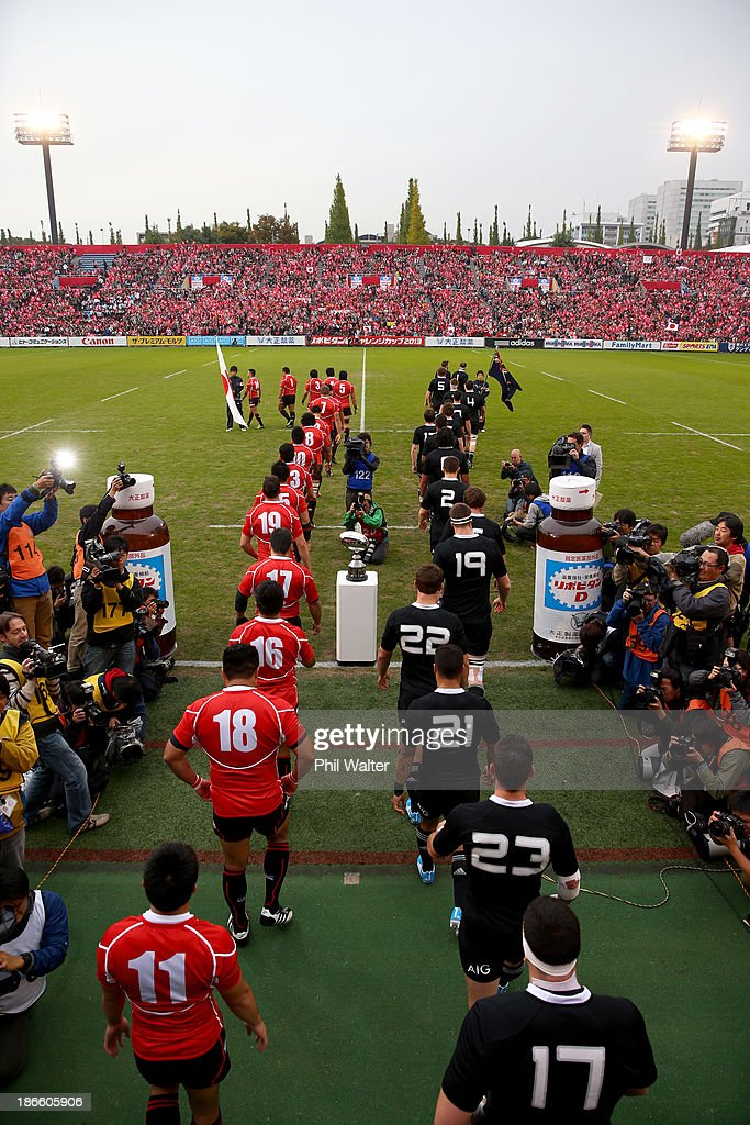 New Zealand and Japan run onto the field for the International Rugby Test Match between Japan and the New Zealand All Blacks at Prince Chichibu Memorial Rugby Stadium on November 2, 2013 in Tokyo, Japan.