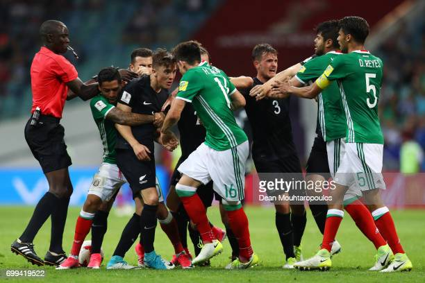 New Zealand and Mexico players clash during the FIFA Confederations Cup Russia 2017 Group A match between Mexico and New Zealand at Fisht Olympic...