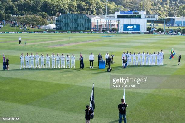 CORRECTION New Zealand and South Africa stand for their national anthems during day one of the 1st International cricket test match between New...