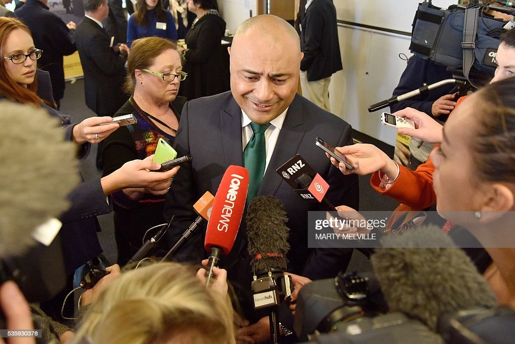 New Zealand Associate Health Minister Sam Lotu-Iiga speaks to the media about the new plain cigarette packaging during an announcement in Wellington on May 31, 2016. New Zealand said it will introduce plain packaging on tobacco products, joining a growing list of countries planning similar measures despite the threat of legal action from the industry. / AFP / Marty Melville