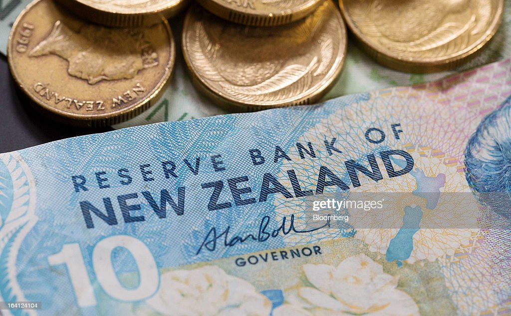 New Zealand banknotes and coins of various denominations are arranged for a photograph in Auckland, New Zealand, on Wednesday, March 20, 2013. The New Zealand dollar, nicknamed the kiwi, fell against most major peers as the government said the country's most widespread drought in at least 30 years reduces pressure to raise interest rates. Photographer: Brendon O'Hagan/Bloomberg via Getty Images