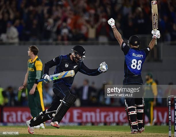 New Zealand batsman Daniel Vettori celebrates with teammate Grant Elliott after their team won the Cricket World Cup semifinal match between New...