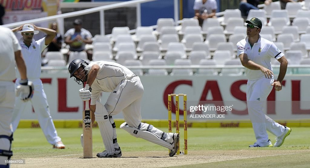 New Zealand batsman Dean Brownile kneels on day 3 of the first Test match between South Africa and New Zealand, in Cape Town at Newlands on January 4, 2013. AFP PHOTO / ALEXANDER JOE