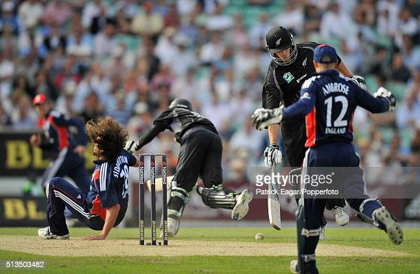 New Zealand batsman Grant Elliot falls after colliding with Ryan Sidebottom of England during the NatWest Series One Day International between...