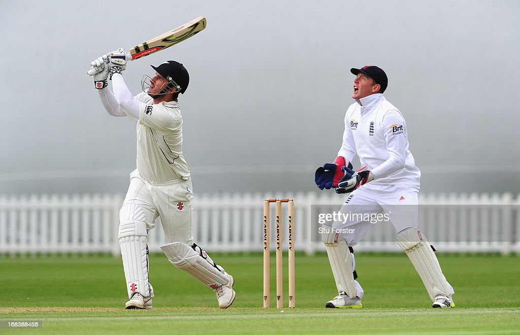 New Zealand batsman <a gi-track='captionPersonalityLinkClicked' href=/galleries/search?phrase=Hamish+Rutherford&family=editorial&specificpeople=4880824 ng-click='$event.stopPropagation()'>Hamish Rutherford</a> hits a six watched by England wicketkeeper <a gi-track='captionPersonalityLinkClicked' href=/galleries/search?phrase=Jonathan+Bairstow&family=editorial&specificpeople=6893210 ng-click='$event.stopPropagation()'>Jonathan Bairstow</a> during day one of the tour match between England Lions and New Zealand at Grace Road on May 9, 2013 in Leicester, England.