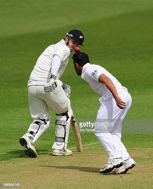 New Zealand batsman Hamish Rutherford looks on as England bowler Ravi Bopara appears to balance the ball on his head during day one of the tour match...