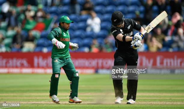 New Zealand batsman James Neesham reacts after being stumped by wicketkeeper Mushfiqur Rahim during the ICC Champions Trophy match between New...