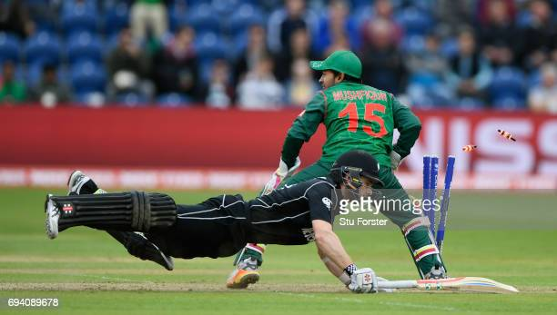 New Zealand batsman Kane Williamson dives to make his ground as wicketkeeper Mushfiqur Rahim removes the bails during the ICC Champions Trophy match...