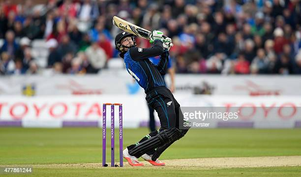 New Zealand batsman Martin Guptill cuts a ball for 6 runs during the 5th Royal London One day international between England and New Zealand at...