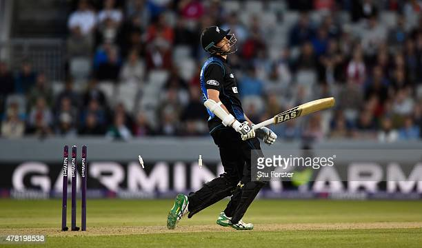 New Zealand batsman Mitchell Santner reacts after being bowled by Mark Wood during the NatWest International Twenty20 match between England and New...