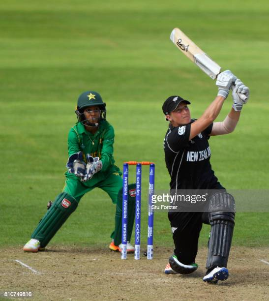 New Zealand batsman Sophie Devine hits a six watched by Pakistan wicketkeeper Sidra Nawaz during the ICC Women's World Cup 2017 match between New...