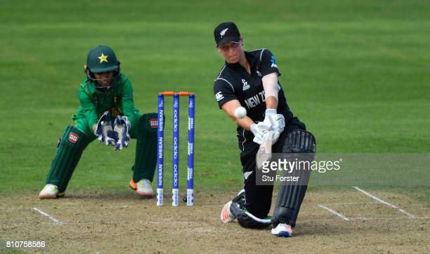 New Zealand batsman Sophie Devine hits one of her nine six hits watched by Pakistan wicketkeeper Sidra Nawaz during the ICC Women's World Cup 2017...