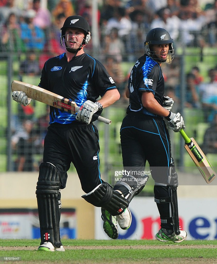 New Zealand batsmen Colin Munro (L) and Ross Taylor (R) run between the wickets during the T20 cricket match between Bangladesh and New Zealand at the Sher-e-Bangla National Cricket Stadium in Dhaka on November 6, 2013. AFP PHOTO/ Munir uz ZAMAN