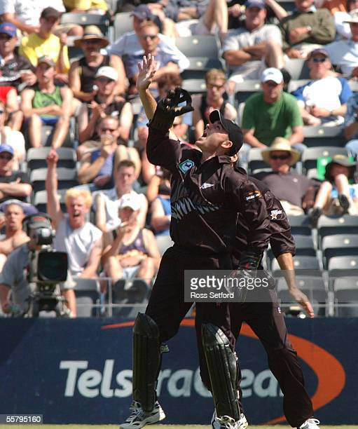 New Zealand Black Caps Brendon McCullum celebrates his catch to dismiss India's Sanjay Bangar for 1 in the third one day cricket international at...