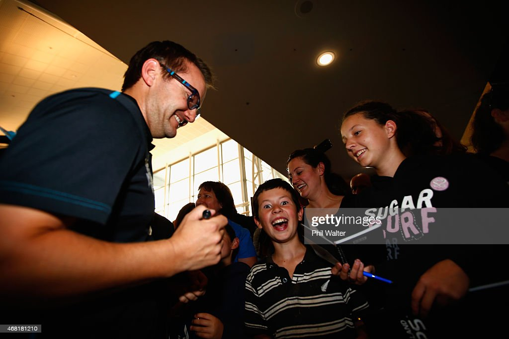 New Zealand Blackcaps coach <a gi-track='captionPersonalityLinkClicked' href=/galleries/search?phrase=Mike+Hesson&family=editorial&specificpeople=9567309 ng-click='$event.stopPropagation()'>Mike Hesson</a> signs autographs after arriving at Auckland Airport on March 31, 2015 in Auckland, New Zealand. New Zealand had their most successful Cricket World Cup campaign by making the final of the tournament for the first time.