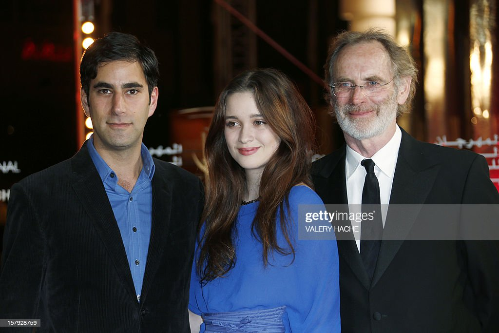 New Zealand born Actress Alice Englert (C) poses with actor Andrew Litvin (L) and film director Christopher Sheppard (R) as they arrive at the 12th Marrakesh International Film Festival on December 7, 2012, in Marrakesh. AFP PHOTO / VALERY HACHE