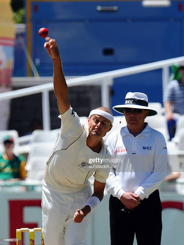 New Zealand bowler Chris Martin delivers a ball to South Africa batsman Alviro Petersen on day one of the first Test match between South Africa and New Zealand in Cape Town at Newlands on January 2, 2013. New Zealand were dismissed for 45. AFP PHOTO / ALEXANDER JOE