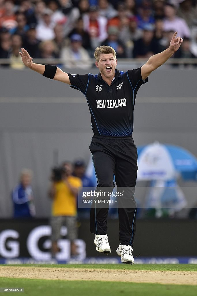 New Zealand bowler <a gi-track='captionPersonalityLinkClicked' href=/galleries/search?phrase=Corey+Anderson+-+Cricket+Player&family=editorial&specificpeople=12457249 ng-click='$event.stopPropagation()'>Corey Anderson</a> celebrates South African batsman Faf du Plessis being caught by New Zealand keeper Luke Ronchi during the Cricket World Cup semi-final match between New Zealand and South Africa at Eden Park in Auckland on March 24, 2015. AFP PHOTO / MARTY MELVILLE