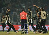 New Zealand bowler Ish Sodhi celebrates the wicket of England team captain Eoin Morgan during the world T20 cricket tournament semifinal match...
