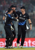 New Zealand bowler James Neesham celebrates the wicket of Sri Lanka batsman Lasith Malinga with teammates during the ICC World Twenty20 tournament...