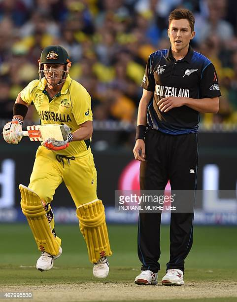 New Zealand bowler Trent Boult reacts as Australian batsmen David Warner takes a run during the 2015 Cricket World Cup final between Australia and...