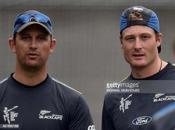 New Zealand bowling coach Shane Bond and cricketer Martin Guptill look on during a training session at the Melbourne Cricket Ground ahead of the 2015...