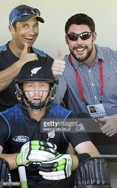 New Zealand bowling coach Shane Bond with NZ Cricket Security consultant Sam Dickason play up behind New Zealand's player Martin Guptill as he waits...