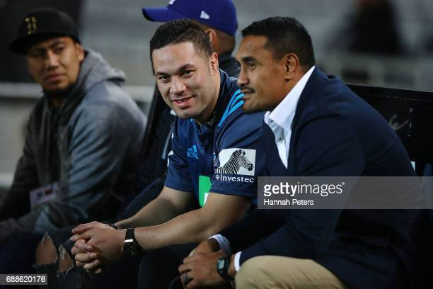 New Zealand boxing champion Joseph Parker sits on the Blues bench with Jerome Kaino of the Blues during the round 14 Super Rugby match between the...