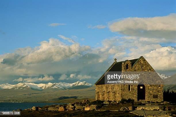 New Zealand, Canterbury, Lake Tekapo,church with mountains behind