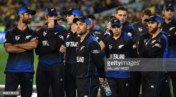 New Zealand captain Brendon McCullum and his team stand after losing in the 2015 Cricket World Cup final against Australia in Melbourne on March 29...