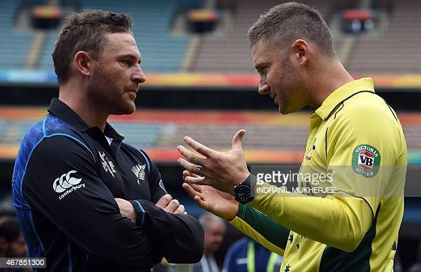 New Zealand captain Brendon McCullum listens to Australian captain Michael Clarke during a photo session with the ICC Cricket World Cup 2015 trophy...
