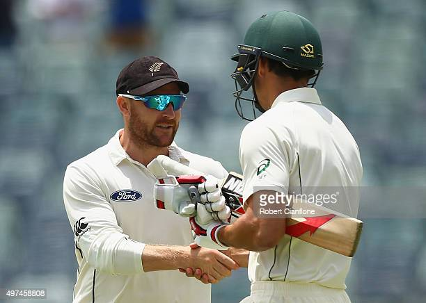 New Zealand captain Brendon McCullum shakes hands with Mitchell Johnson of Australia during day five of the second Test match between Australia and...