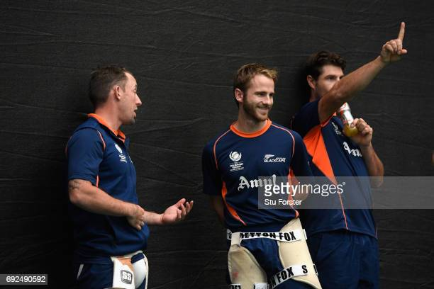 New Zealand captain Kane Williamson chats with Luke Ronchi during nets at the Swalec Stadium ahead of the ICC Champions Trophy match between England...