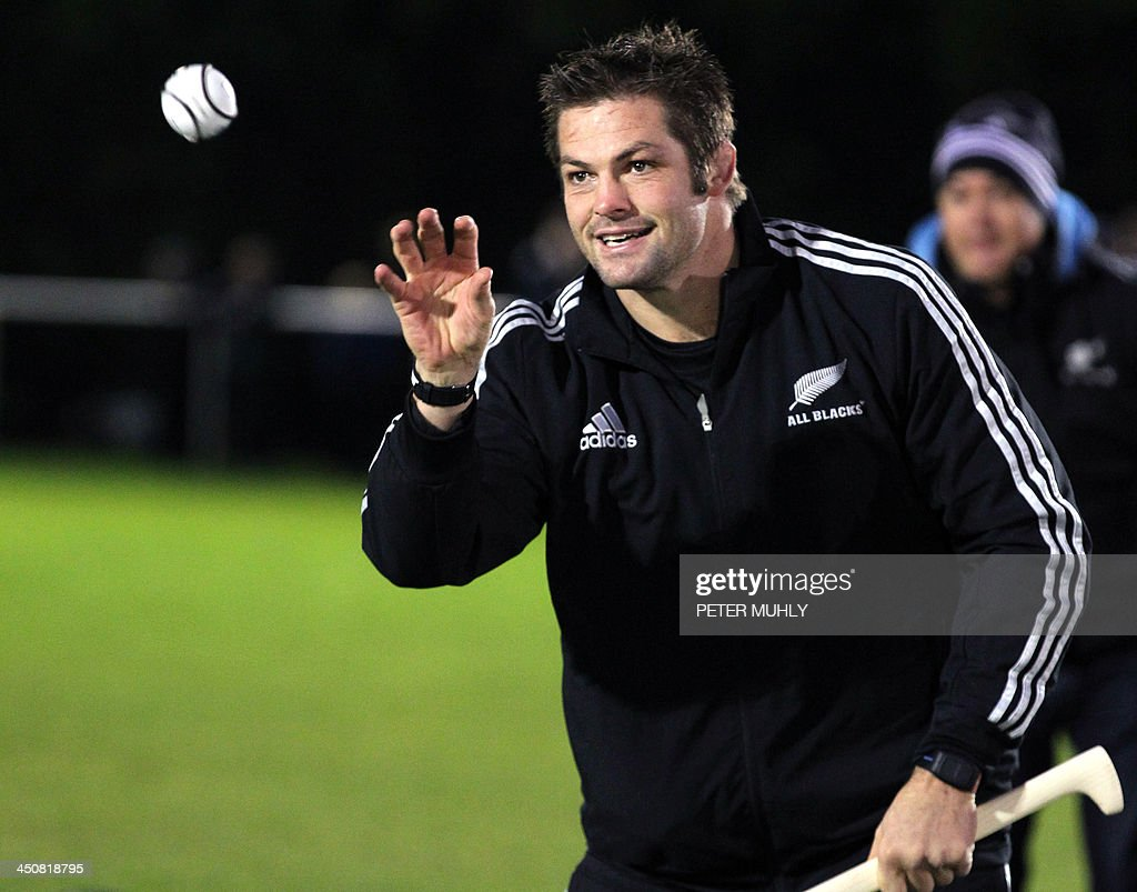 New Zealand captain Richie McCaw catches a hurley ball during a skills sessions with Irish hurling and football players at Westmanstown Sports Centre in Dublin, Ireland, on November 20, 2013. The All Blacks will attempt to become the first major international side of rugby union's professional era to win all their matches in a calendar year when they face Ireland on November 24, 2013.