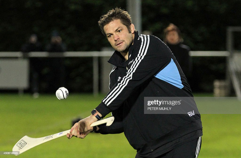 New Zealand captain Richie McCaw hits a hurley ball during a skills sessions with Irish hurling and football players at Westmanstown Sports Centre in Dublin, Ireland, on November 20, 2013. The All Blacks will attempt to become the first major international side of rugby union's professional era to win all their matches in a calendar year when they face Ireland on November 24, 2013. AFP PHOTO/ PETER MUHLY