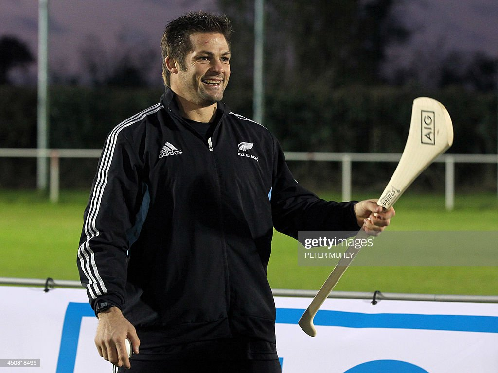 New Zealand captain Richie McCaw holds a hurly stick during a skills sessions with Irish hurling and football players at Westmanstown Sports Centre in Dublin, Ireland, on November 20, 2013. The All Blacks will attempt to become the first major international side of rugby union's professional era to win all their matches in a calendar year when they face Ireland on November 24, 2013.