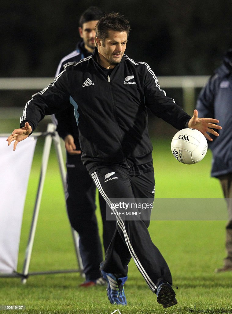 New Zealand captain Richie McCaw kicks a ball during a skills sessions with Irish hurling and football players at Westmanstown Sports Centre in Dublin, Ireland, on November 20, 2013. The All Blacks will attempt to become the first major international side of rugby union's professional era to win all their matches in a calendar year when they face Ireland on November 24, 2013.