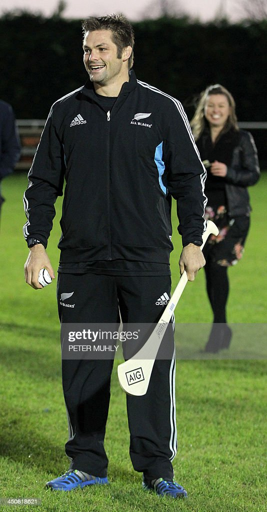 New Zealand captain Richie McCaw prepares to hit a hurley ball during a skills sessions with Irish hurling and football players at Westmanstown Sports Centre in Dublin, Ireland, on November 20, 2013. The All Blacks will attempt to become the first major international side of rugby union's professional era to win all their matches in a calendar year when they face Ireland on November 24, 2013.