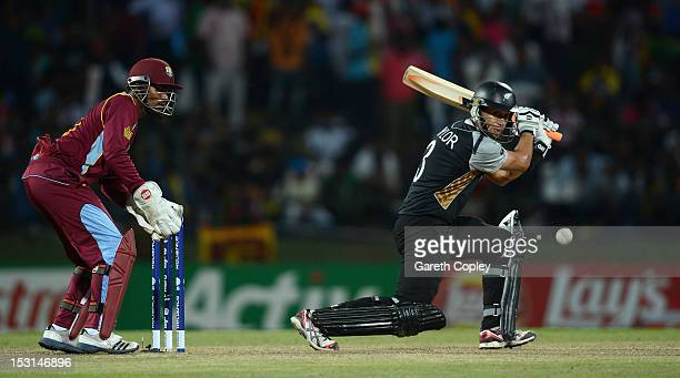 New Zealand captain Ross Taylor bats watched by West Indies wicketkeeper Denesh Ramdin during the ICC World Twenty20 2012 Super Eights Group 1 match...