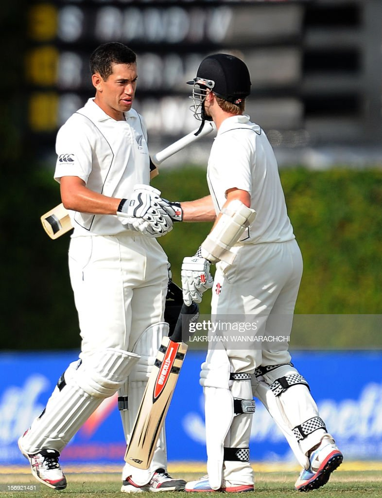 New Zealand captain Ross Taylor (L) is congratulated by teammate Kane Williamson after scoring a century (100 runs) during the first day of the second and final Test match between Sri Lanka and New Zealand at the P. Sara Oval Cricket Stadium in Colombo on November 25, 2012.