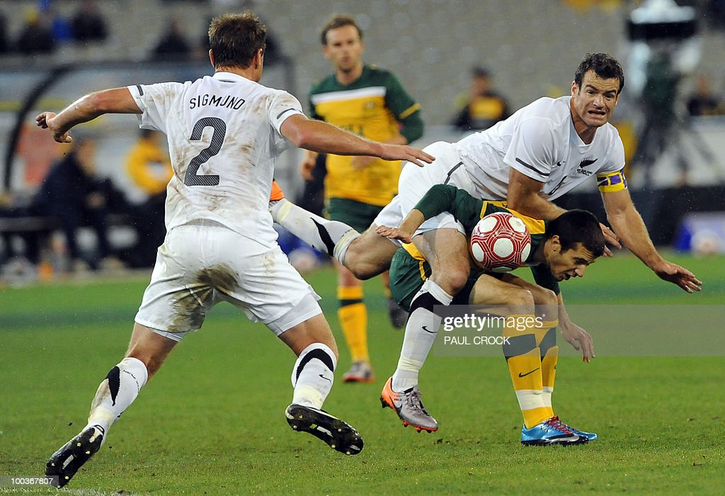 New Zealand captain Ryan Nelsen (R top) lands on top of Nikita Rukavytsya of Australia (R bottom) as Ben Sigmund of New Zealand (L) looks on during their friendly international football match in Melbourne on May 24, 2010. Australia won the match 2-1. RESTRICTED